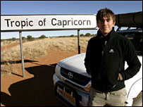Simon Reeve standing at the Tropic of Capricorn in Namibia
