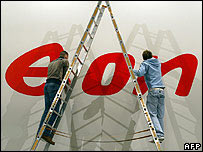 Men working on the logo of German power giant E.ON