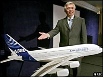 Airbus' John Leahy gestures at a model of the A380