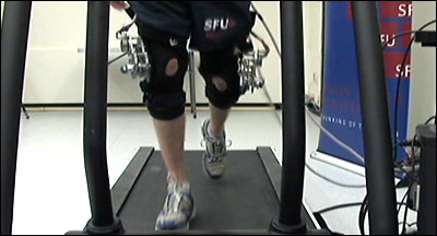 Dynamo generators attached to legs while being tested on a treadmill