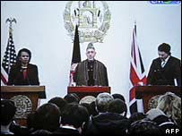 Condoleezza Rice, Hamid Karzai and David Miliband at a news conference in Kabul on Thursday