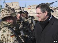 Germany's Defence Minister Franz-Josef Jung left talks to German Isaf soldiers in Afghanistan (30 Jan 08)