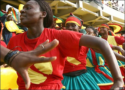Cameroon fans dance in the stands before kick-off