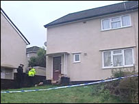 The house in Grovers Close, Glyncoch with police tape around it