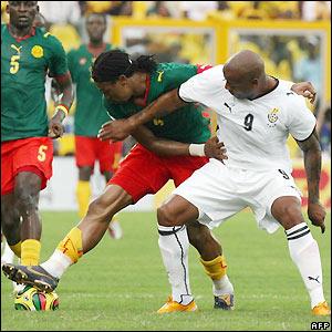 Rigobert Song holds off Junior Agogo