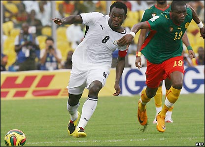 Essien contests possession with Stephane Mbia