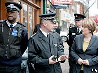 Home Secretary Jacqui Smith (right) and police officers