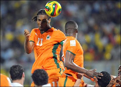 Drogba sends a header goalwards