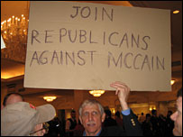Bob Shoemaker from Virginia holds a Republicans Against McCain sign