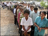 People wait outside the court in Phnom Penh on 7 February 2008