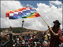 A man waves a flag symbolising the Inca Empire during a protest in Cuzco, Peru