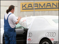 A worker at the plant of German car parts supplier Karmann