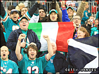 NFL fans with Italy and Scotland flags at Wembley
