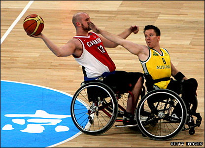 Australian and Canadian wheelchair basketball players in action in Beijing