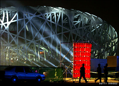 Workers leave the 'Bird's Nest' stadium in Beijing