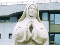 Statue of St Bernadette, founder of the Lourdes sanctuary