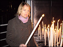 Emma Jane Kirby lighting a candle
