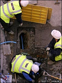 Thames Water workers dig up a residential street
