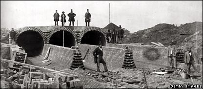 Bazalgette - top right - and others view the Northern Outfall sewer being built below the Abbey Mills pumping station
