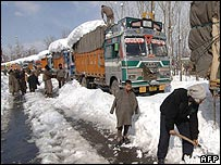 Trucks waiting along highway in Indian-administered Kashmir