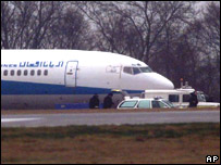 A hijacked Afghan plane sits at London's Stansted Airport in 2000