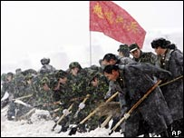 Soldiers shovelling snow in China