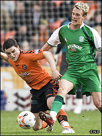 Craig Conway and Deam Shiels tussle for the ball at Tannadice