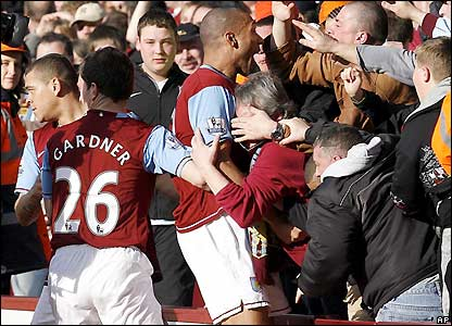 Carew celebrates after giving Villa the lead