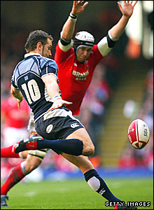 Scotland fly-half Dan Parks is pressurised into a clearance by Wales captain Ryan Jones