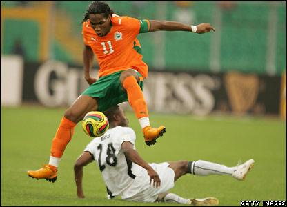 Drogba hurdles Eric Addo's tackle