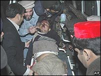 Victim of Charsadda bombing is helped.  9 Feb 2008