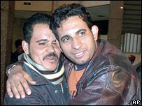 Convert Yasser Helmy (r) and an unidentified colleague celebrate at the court