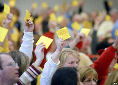 Voters hold up registration sheets at the Democratic Caucuses in Papillion, Nebraska, 9 February 2008