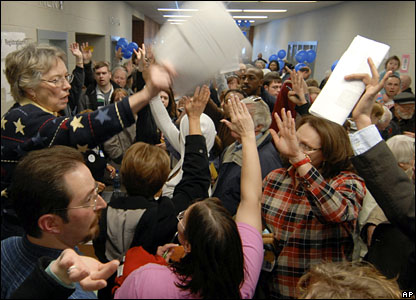 Registration sheets are handed out at the Democratic caucus in Papillion, Nebraska, 9 February 2008
