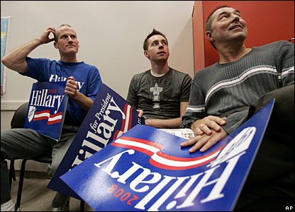 Richard Burton, left, Justin Giossi, and Joe Varano, look on as delegates are nominated from their district at a Democratic caucus in Seattle, 9 February 2008