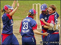 England celebrate after Nick Shaw dismisses Shelley Nitschke