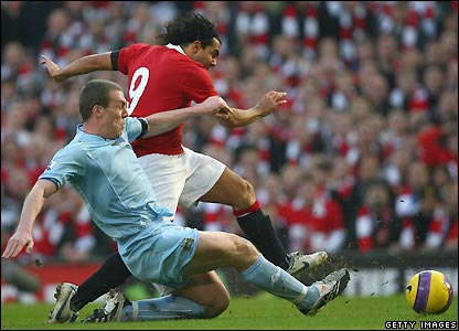 Tevez goes close