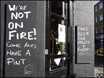 Pub sign says 'we're not on fire'