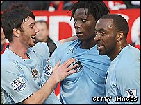 Man City's Stephen Ireland (left) and Darius Vassell (right) congratulate Benjani after his goal in the 2-0 win over Man Utd