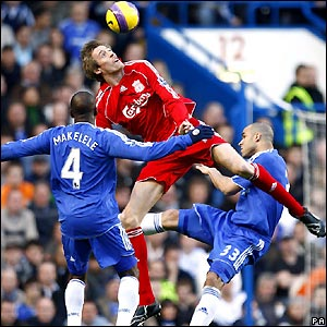 Crouch goes up for a header