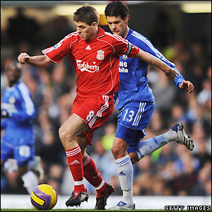 Gerrard looks to bring the ball away from Ballack