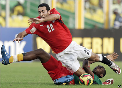Mohamed Aboutrika takes a tumble