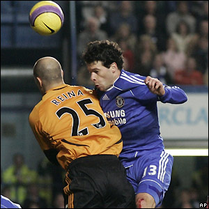 Jose Reina and Michael Ballack contest possession
