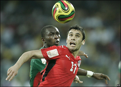 Hassan holds off Mbia