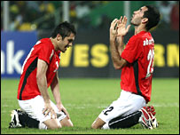 Goalscorer Mohamed Aboutrika (right) with captain Ahmed Hassan