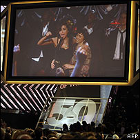 Amy Winehouse and mother Janis seen on a screen at the Grammy Awards