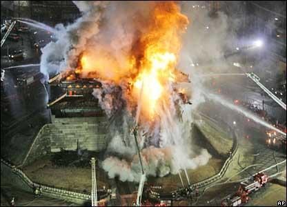 Firefighters battle a blaze at Namdaemun, Seoul, 11 February 2008