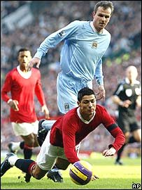 Cristiano Ronaldo loses out in a challenge with Man City's Dietmar Hamann
