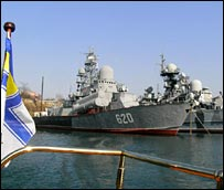 Russian ship with Ukrainian flag in foreground