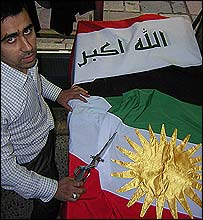 Tailor Muhammad Ibrahim making flags